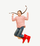 Isolated photo from top of happy jumping girl in red rubber boot Stock Photography