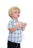 Isolated photo of young boy taking a photograph Stock Photo