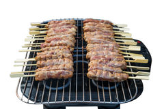 The isolated picture of grilled pork on the electronic stove Stock Images