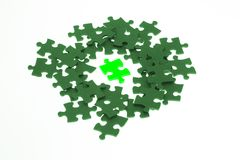 Isolated piece of green lumious jigsaw puzzle Stock Image