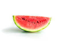 Isolated piece of watermelon with seeds visible. On white background, quarter sideview, healthy eating, sweet summer refreshment Stock Photo