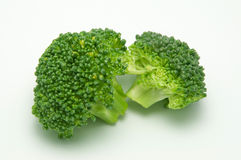 Isolated pieces of brocoli. Two pieces of brocoli isolated on white stock photo