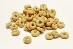 Isolated pile of cereal on white background royalty free stock photos