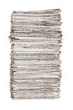 Isolated pile of newspapers Royalty Free Stock Image