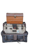 Isolated pile of old luggage. Two old suitcases and a trunk isolated on a white background Royalty Free Stock Photos
