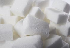 Isolated pile of sugar cubes close up view in sweet nutrition and diet concept Stock Photos