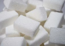 Isolated pile of sugar cubes close up view in sweet nutrition and diet concept Stock Photography