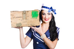 Isolated pin up girl holding a military arms box Royalty Free Stock Photo