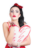 Isolated pin up woman holding a heart shaped sign Stock Photo