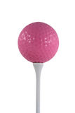 Isolated Pink Golf Ball On A White Tee Royalty Free Stock Photos