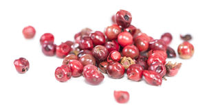 Isolated Pink Peppercorns. Pink Peppercorns isolated on pure white background royalty free stock image