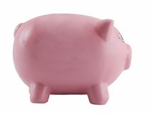 Isolated pink piggy bank. A close up view of the side of a large, pink piggy bank, isolated on white background.  Theme:  Savings, banking, frugality, thrift Royalty Free Stock Photography