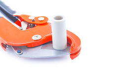 Isolated pipe cutter with plastical pipe close up Royalty Free Stock Photos