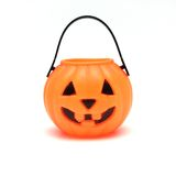 Isolated Plastic Jack-o-lantern. Orange Plastic Jack-O-Lantern on White Background Stock Images