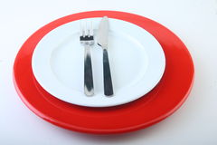 Isolated plate. Isolated red plate on white background Royalty Free Stock Photos