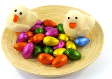 An isolated plate of bamboo with Easter eggs and ducklings Royalty Free Stock Photo