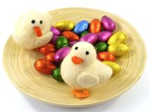 An isolated plate of bamboo with Easter eggs and ducklings Royalty Free Stock Photos