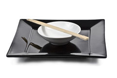 Isolated plate with chopsticks. Isolated B&W square plate with chopsticks Stock Images