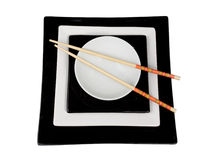 Isolated plate with chopsticks. Isolated B&W square plate with chopsticks Stock Photo