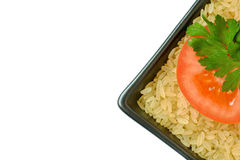 Isolated plate with rice and tomato Stock Images