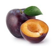 Isolated plums. Whole and a half of blue plum fruit with leaves isolated on white background, with clipping path stock image