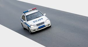 Isolated police car on road. An isolated police car on road Royalty Free Stock Image