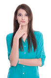 Isolated pondering woman in green blouse. Royalty Free Stock Photos
