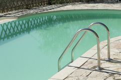 Isolated pool ladder - Swimming pool details. Marche, Italy, Europe stock photography
