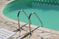 Isolated pool ladder - Swimming pool details. Marche, Italy, Europe royalty free stock images