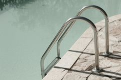 Isolated pool ladder - Swimming pool details. Marche, Italy, Europe royalty free stock photo