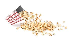 Popcorn poured from a paper cup Stock Image