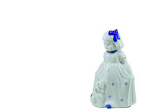 Isolated porcelain figurine of a little girl. Isolated porcelain figurine of a little girl with the lamb Royalty Free Stock Photos