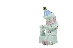 Isolated porcelain figurine sad clown. Stock Photos