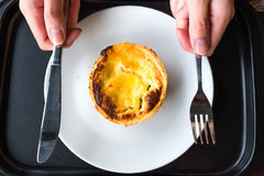 Isolated Pork Ham Quiche with Someone Hold Fork and Knife. Isolated Pork Ham Quiche Served on white dish with Someone Hold Fork and Knife Royalty Free Stock Photo