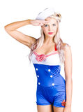 American pinup girl sailor saluting a yes sir. Isolated portrait of a beautiful blond american pin-up girl sailor saluting with a Yes Sir on white background Stock Photography