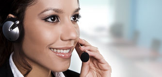 Isolated portrait of a beautiful helpdesk. Or support line operator answering a call royalty free stock images