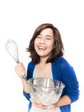 Isolated portrait of beautiful young success woman with whisk an Stock Image