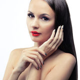 Isolated portrait of a brunette. With red lips Royalty Free Stock Photo