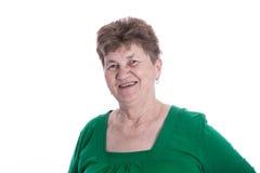Isolated portrait of brunette smiling senior woman over white. Royalty Free Stock Image