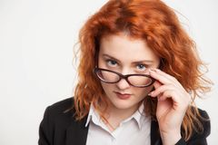 Isolated portrait of a business girl holding glasses stock photo