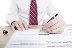 Isolated portrait of a businessman signing a contract stock image