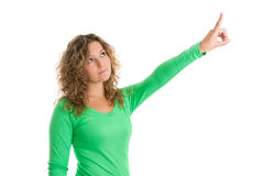 Isolated portrait of caucasian woman pointing on white. Royalty Free Stock Photo
