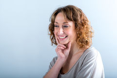 Isolated portrait of a cheerful and happy young woman. Laughing Stock Images