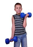 Isolated portrait of child exercising with dumbbells Royalty Free Stock Image