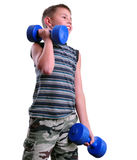 Isolated portrait of child exercising with dumbbells Stock Image