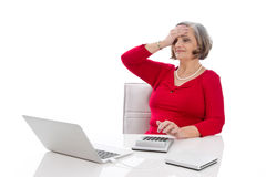 Isolated portrait of a desperate senior female business woman. Royalty Free Stock Photography