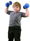 Isolated portrait of elementary age boy with dumbbells exercising Stock Photo