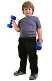 Isolated portrait of elementary age boy with dumbbells exercising Royalty Free Stock Photo