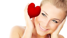 Isolated portrait of a female holding heart Stock Photography