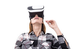 Isolated portrait of a girl in vr glasses. Close up portrait of a girl wearing a virtual reality glasses and looking upwards. Isolated. Mock up Stock Photography